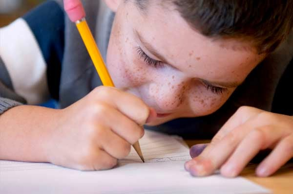 boy-writing-with-pencil