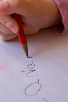 Child Writing her Name