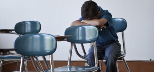Sad boy in a classroom